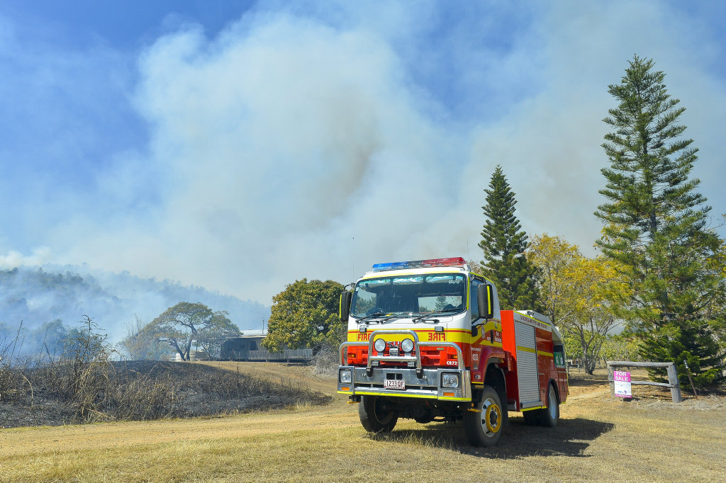Ten fire crews battled a bushfire west of Calliope on Father's Day, which broke out near properties on Potters Road.