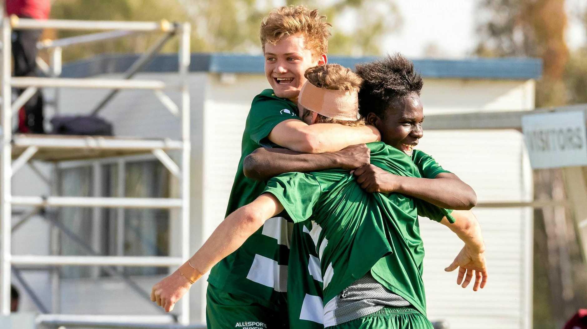 Western Pride players celebrate Griffin Trevett-Lyall's goal in the under-18 semi-final win over Brisbane Roar.