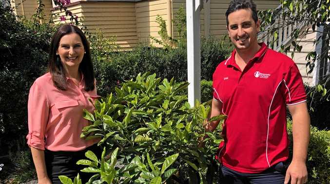PLANTS: Queensland Urban Utilities spokesperson Michelle Cull and Sam Mattioli of Hospitality Plumbing with a Native Gardenia.