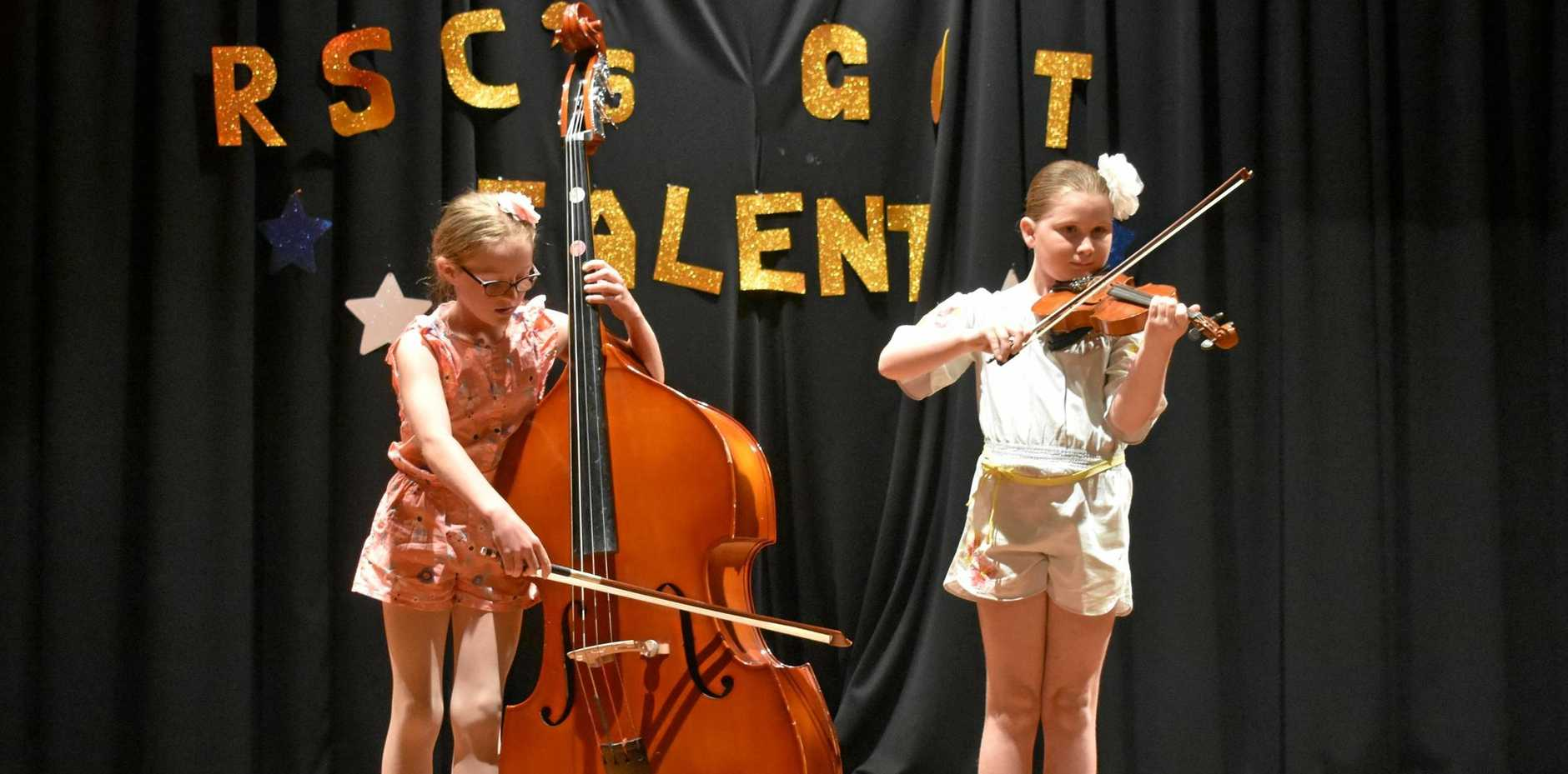 CLASSIC COMPANIONS: Jacqui Flower and Cleo Ferguson perform at Roma State College's talent night on Friday.