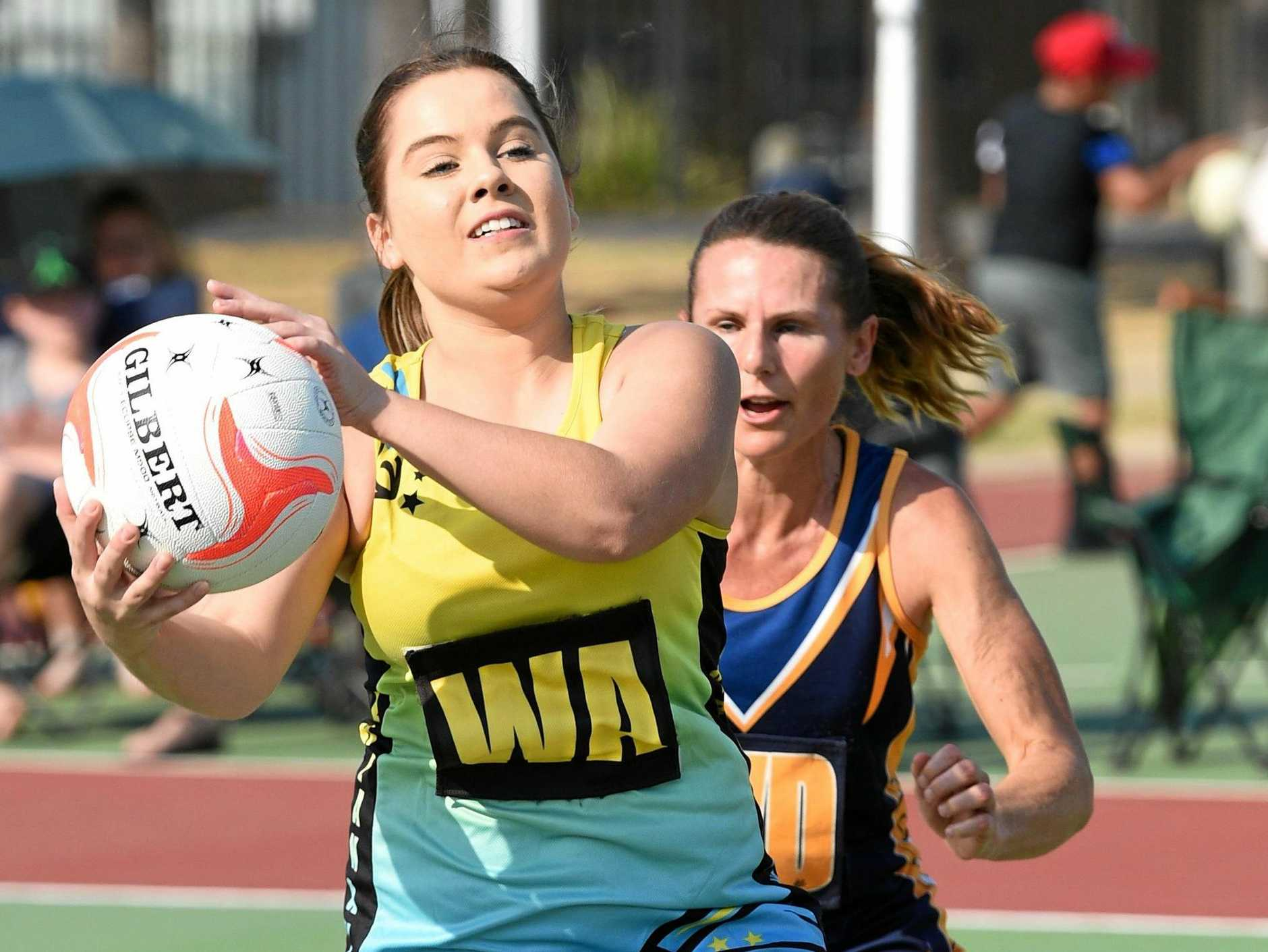 IN THE CLEAR: Breakaways wing attack Aleyeah O'Keefe takes clean possession during Saturday's Division 1 grand final.