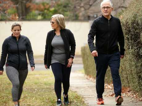 Betrayed: Former prime minister Malcolm Turnbull with his wife Lucy and daughter Daisy walking together in Canberra last week. Picture Jonathan Ng
