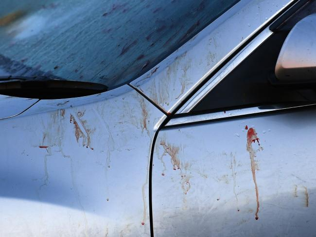 Blood is seen on a car at the scene of a brawl in Mater Street, Collingwood. Picture: Julian Smith