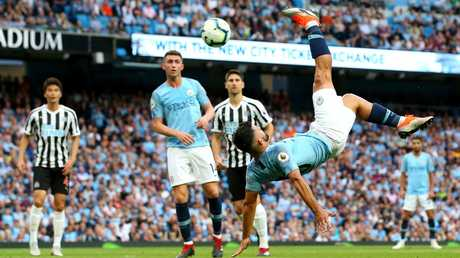 Sergio Aguero attempts an overhead kick.
