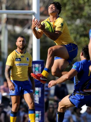 Karmichael Hunt soars for Brisbane City. Picture: AAP