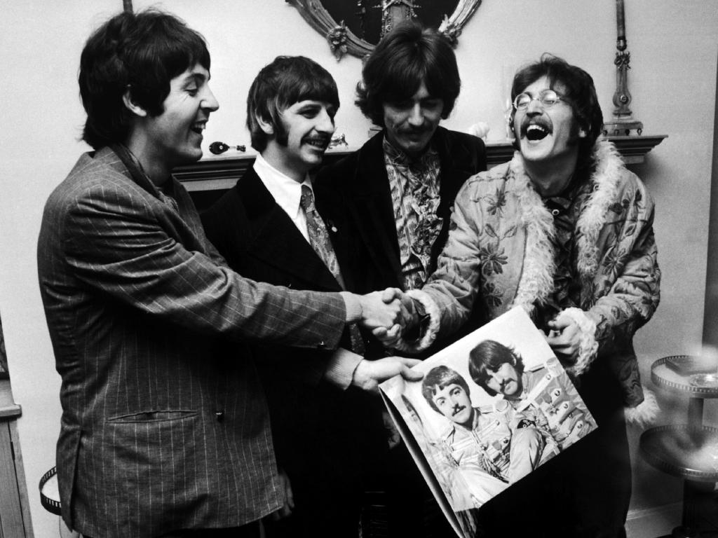 The Beatles (left to right) George Harrison (1943 — 2001), Ringo Starr, John Lennon (1940 — 1980) and Paul McCartney, hold the sleeve of their new LP, 'Sgt. Pepper's Lonely Hearts Club Band', in 1967. Picture: John Downing/Getty
