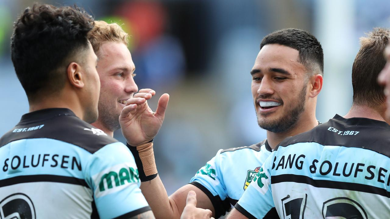 Cronulla's Valentine Holmes celebrates a try by Sosaia Feki during the Cronulla Sharks v Bulldogs NRL match at ANZ Stadium, Homebush. Picture: Brett Costello