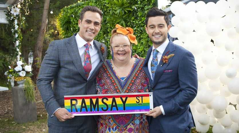 Magda Szubanski plays wedding celebrant Jemima Davies-Smythe for Neighbours' first same-sex wedding. Pictured with Matt Wilson and Takaya Honda.