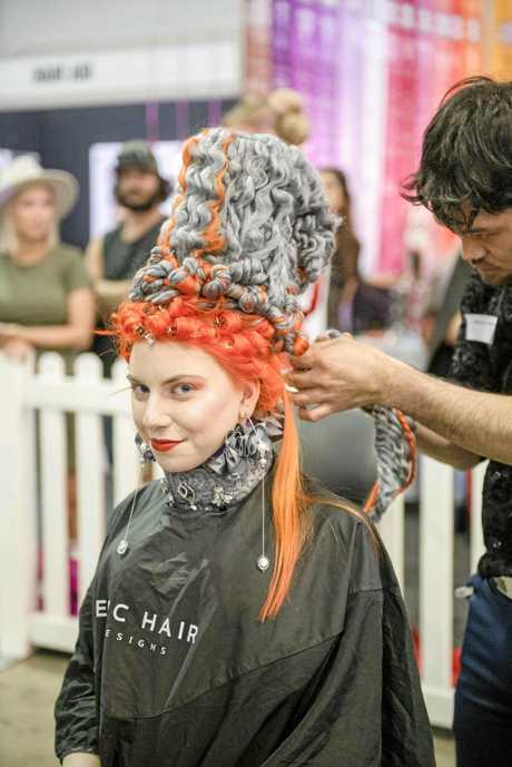 Pirekopa Taylor designs his avant garde winning piece at the Brisbane Hair Expo on model Rebecca Madigan.