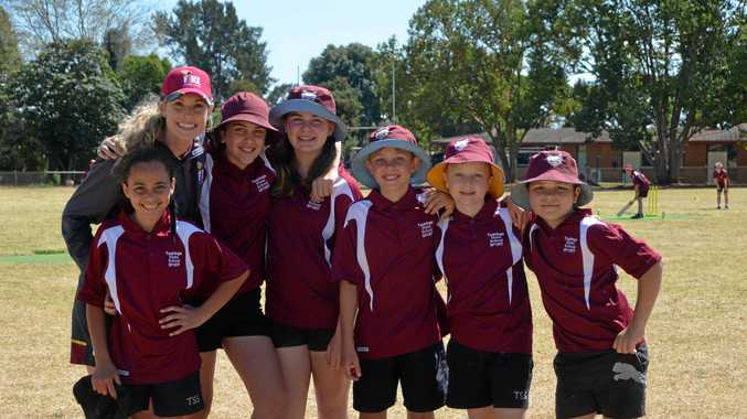 HIT FOR SIX: Holly Ferling with Taabinga State School students at the South Burnett school challenge.