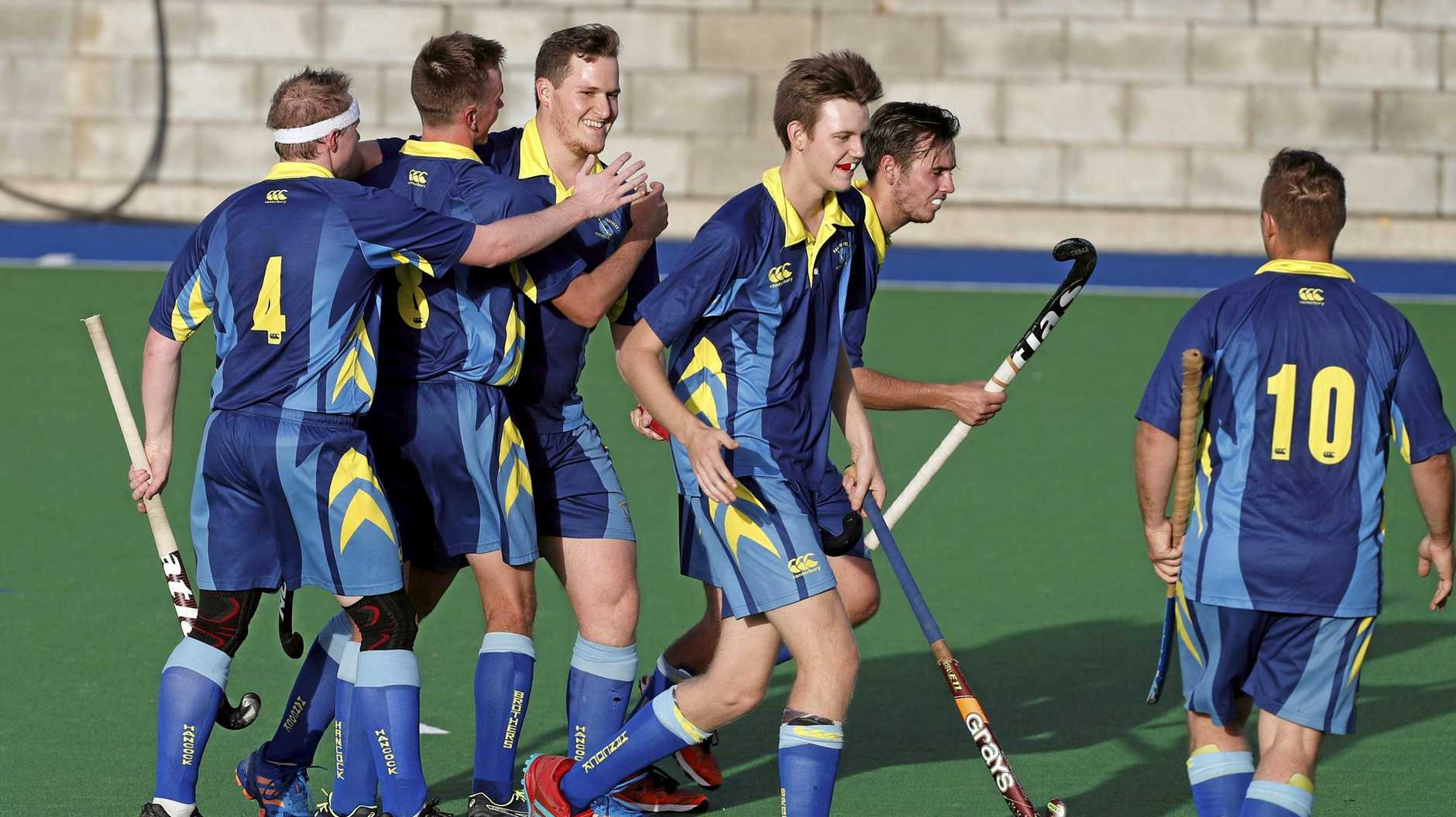 Hancocks Reserve Grade players celebrate one of the five goals they scored in Saturday's elimination final win over Bellbowrie at the Ipswich Hockey Complex.