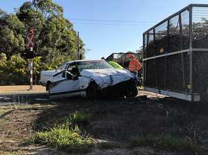 Man in serious condition after ute hits cane train