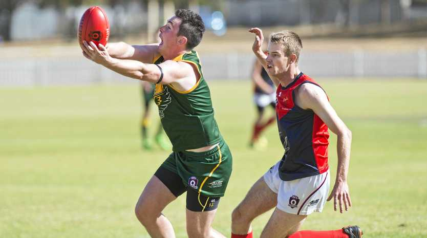 CLUTCH GRAB: Joe Verney of the Goondiwindi Hawks reaches out to take a mark in front of Warwick's Mitchell Darton during their preliminary final at Rockville Oval.