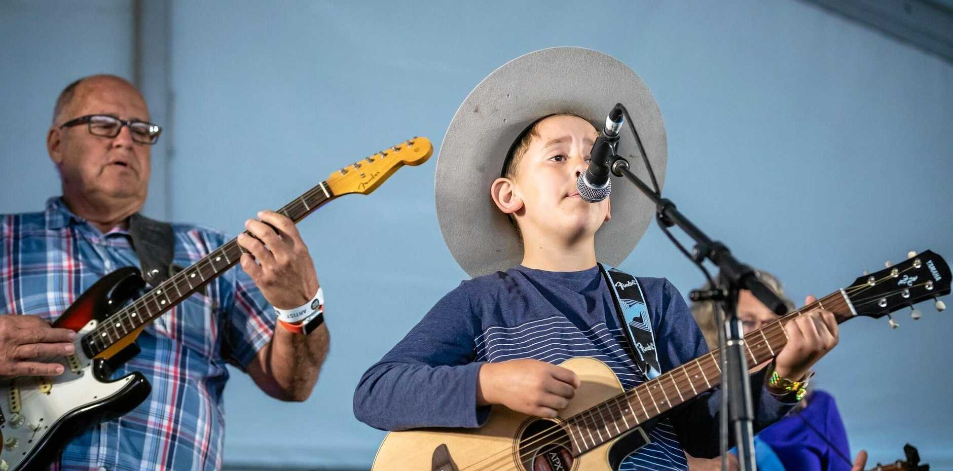 MUSTER MILESTONE: Gayndah's nine-year-old Noah Coulson stepped on a Gympie Muster stage for the first time in 2018, alongside his grandfather Dr Geoff Walden.