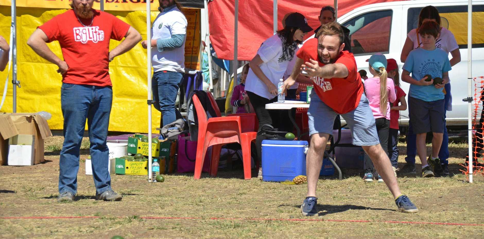 Jacob Dryer from QUT Big Lift rolls down the avocado roll track at the Blackbutt Avocado Festival, September 9 2017.
