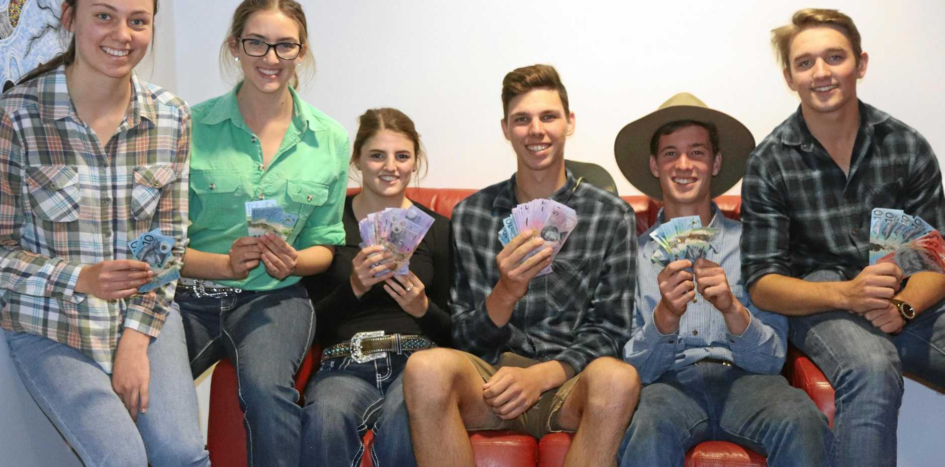 DOLLARS: St Joey's students collect money to help out farmers.
