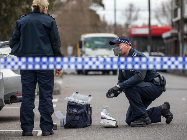Police gather evidence at the scene of the violent Collingwood brawl. Picture: Sarah Matray