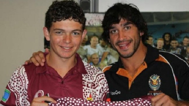 Ashley Taylor, pictured here meeting his idol when still a teen, has been anointed as one of the players set to carry on as an indigenous leader in the game after Thurston's retirement.