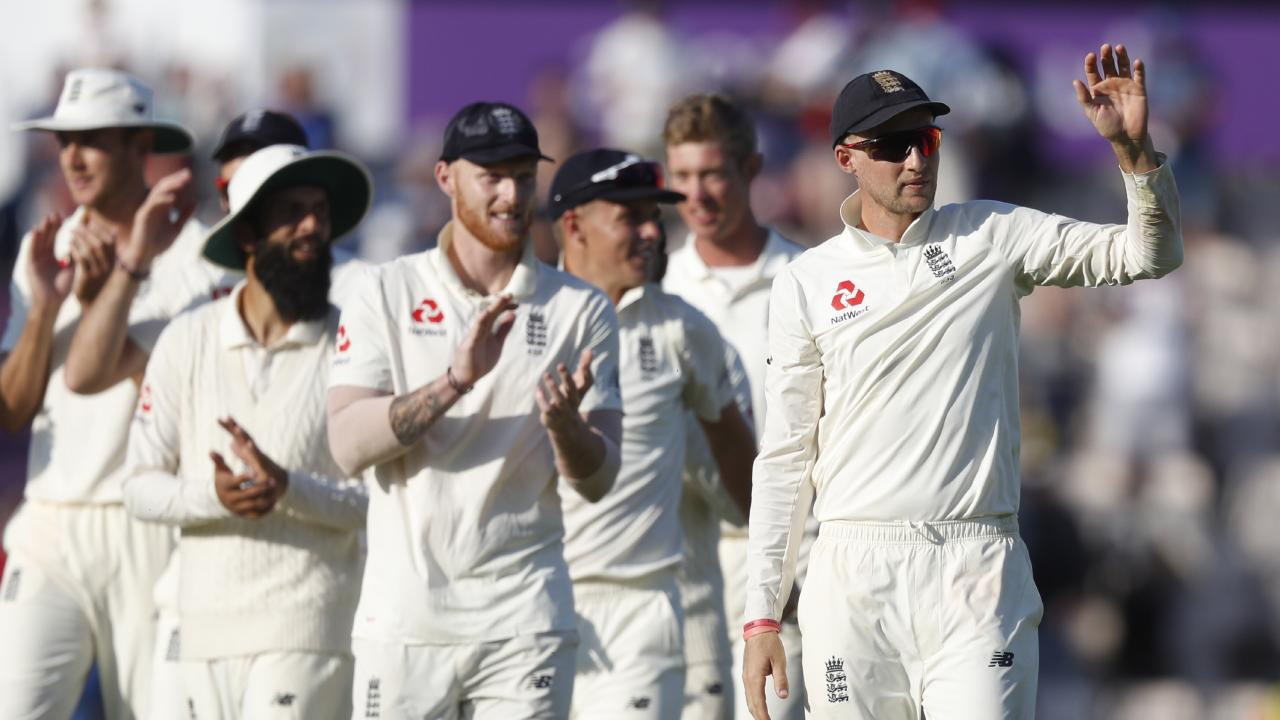 England's Joe Root, right, leads his players from the pitch after England defeated India on the fourth day of the 4th cricket test match between England and India at the Ageas Bowl in Southampton, England, Sunday, Sept. 2, 2018. England and India are playing a 5 test series. (AP Photo/Alastair Grant)