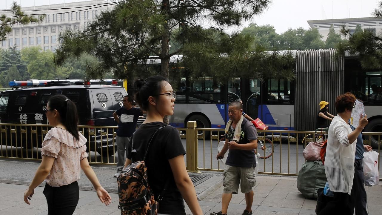 Ren Liping in Beijing at the police headquarters to file a petition to have her case re-examined.Picture: AP Photo/Andy Wong