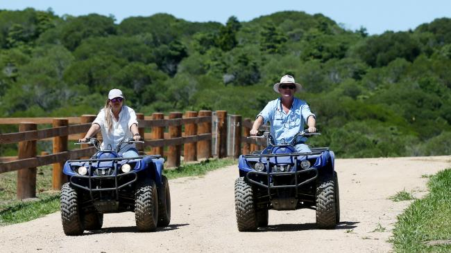 Kur-World's Sharon Sou and John Riordan tour the property on quad bikes.