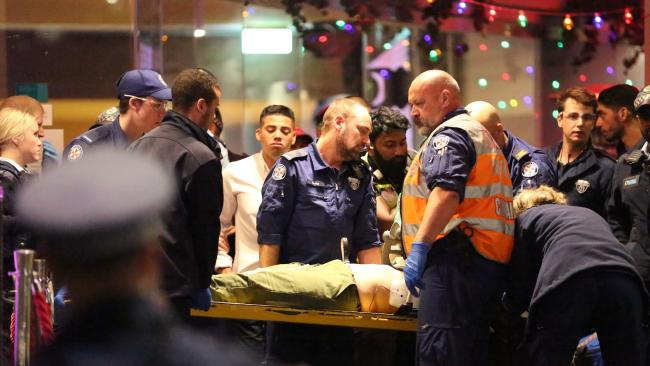 Police had to protect paramedics in Darling Harbour last month while they treated an unconscious woman.