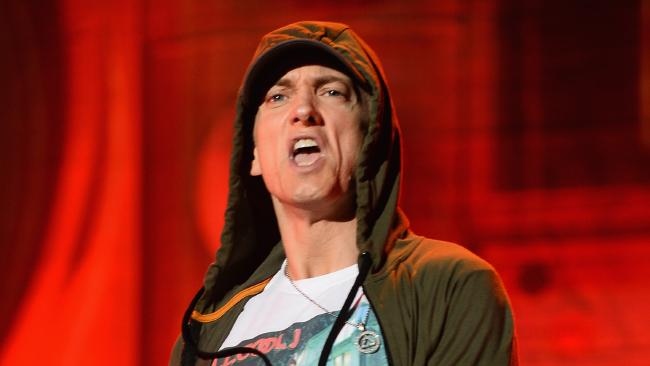CHICAGO, IL - AUGUST 01: Eminem performs at Samsung Galaxy stage during 2014 Lollapalooza Day One at Grant Park on August 1, 2014 in Chicago, Illinois. (Photo by Theo Wargo/Getty Images)