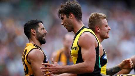 Paul Puopolo of the Hawks remonstrates with Alex Rance of the Tigers earlier this season. Picture: Adam Trafford/AFL Media/Getty Images