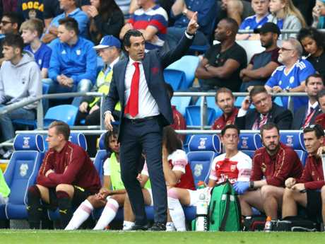 Unai Emery, Manager of Arsenal and Mesut Ozil of Arsenal look on from the touchline during the Premier League match between Cardiff City and Arsenal FC. Picture: Getty Images