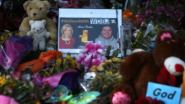 Adam Ward and Alison Parker honoured at a make shift memorial.Picture: Getty Images