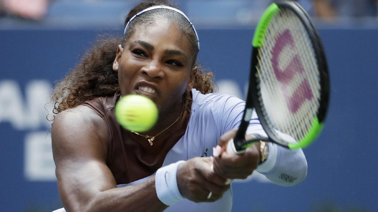 Serena Williams returns a shot to Kaia Kanepi during the fourth round of the U.S. Open tennis tournament. Picture: AP Photo