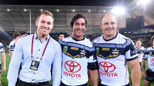 Thurston celebrates his last NRL match with team mates Michael Morgan and Matt Scott  at Cbus Super Stadium.