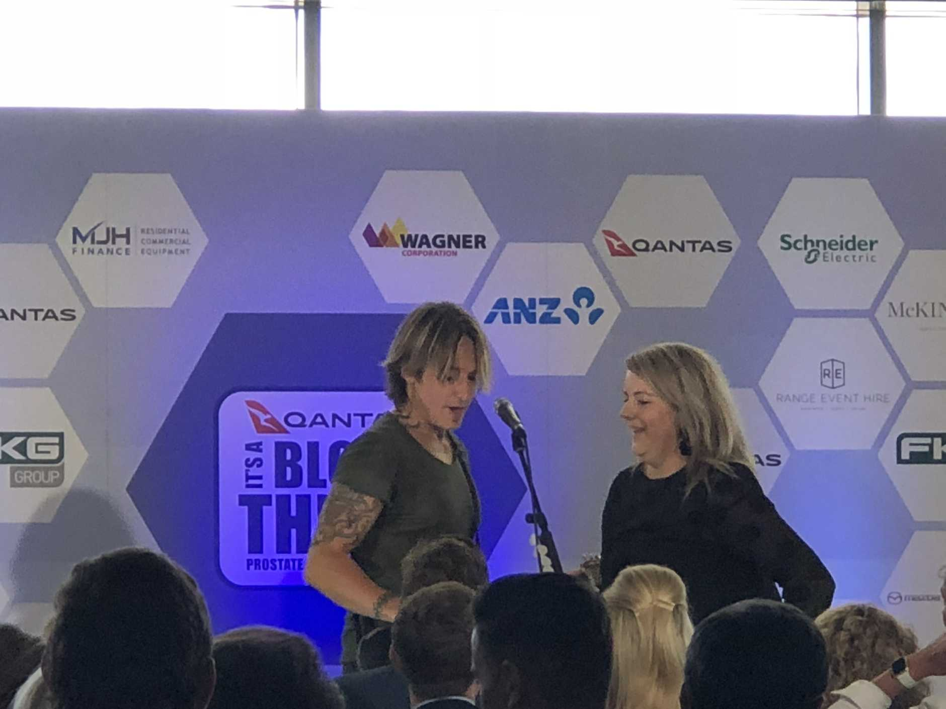 Keith Urban performs with Sam Duggan at Wellcamp Airport