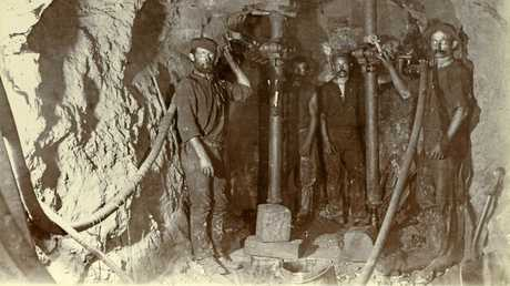 Miners working underground in the Mount Morgan Mine in the early 20th Century. Photo Courtesy the State Library of Queensland.