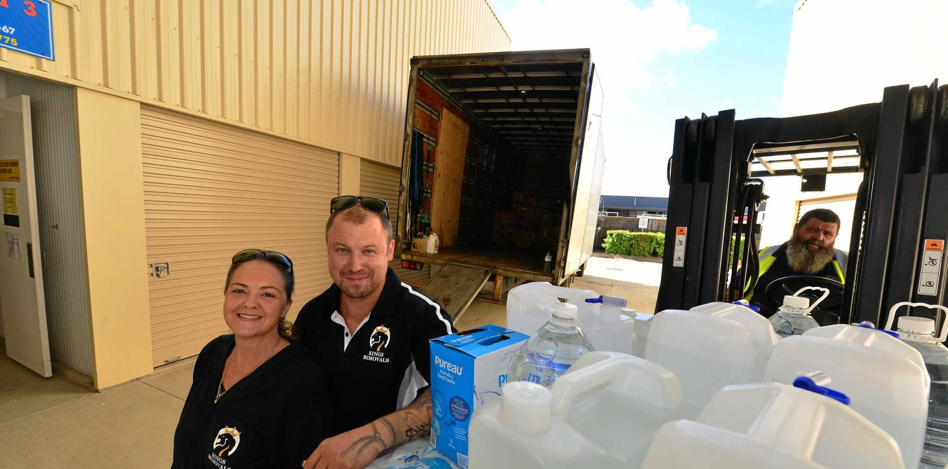 HELPING HAND: Casey Langton and Scott Fouchard of National Storage Coolum prepare to transport goods out west to struggling farmers.