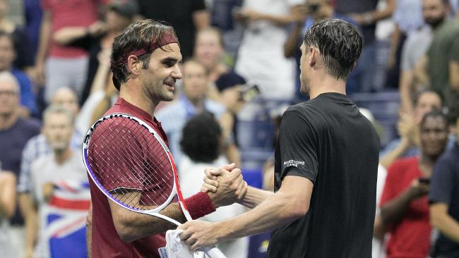 Roger Federer congatulates John Millman after the biggest win of the Australian's career.