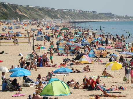 People sunbathe on Boscombe beach in Dorset. Picture: Andrew Matthews/PA/Getty