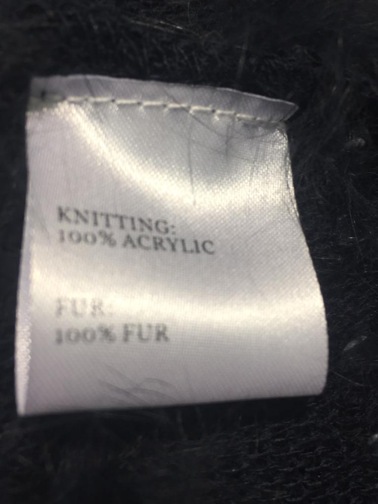 The label on the fur poncho.