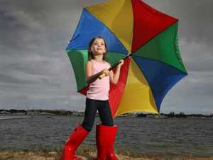 Umbrellas at the ready, here comes the rain