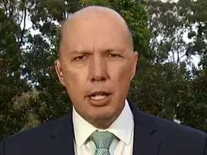 Dutton fires up over 'dirt file' threat