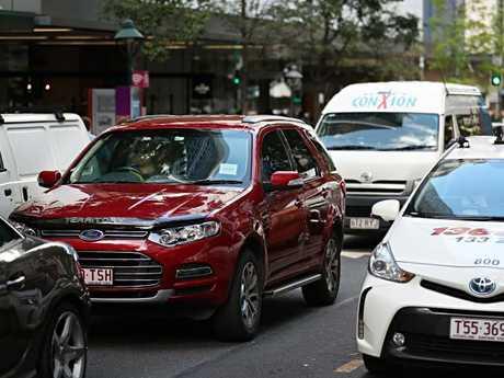 Various transport options clog Albert St in Brisbane's CBD. Picture: Annette Dew