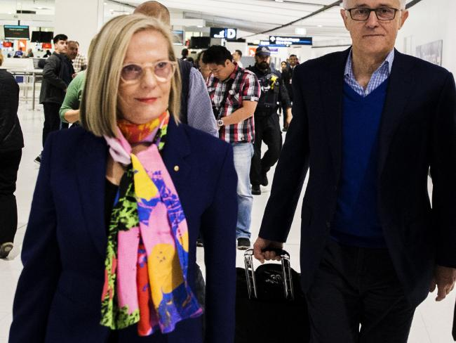 The Turnbulls were accompanied by a security detail as they left Sydney International airport after the ousted PM stood down from the seat of Wentworth. Picture: Jenny Evans