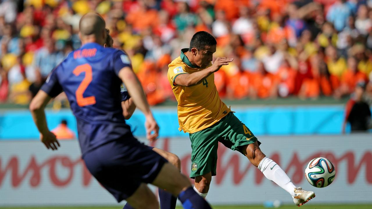 Tim Cahill scores against the Netherlands.