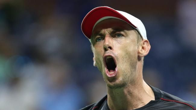John Millman of Australia is fired up during the men's singles fourth round match against Roger Federer at the US Open. Picture: Getty Images