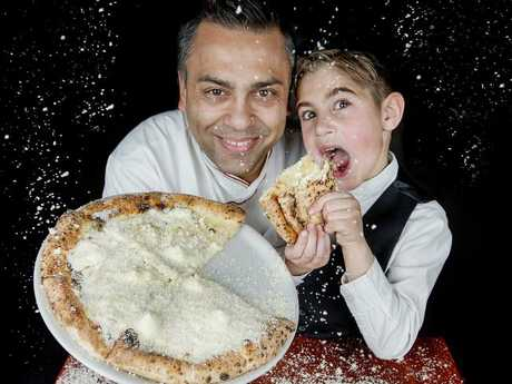 Johnny di Francesco and Mario, 7 with the world's cheesiest pizza. Picture: Ian Currie
