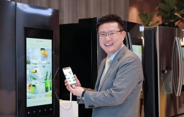 Sunggy Koo, the vice president of Smart Appliances and Home IOT (Internet of Things), with the Family Hub smart fridge.