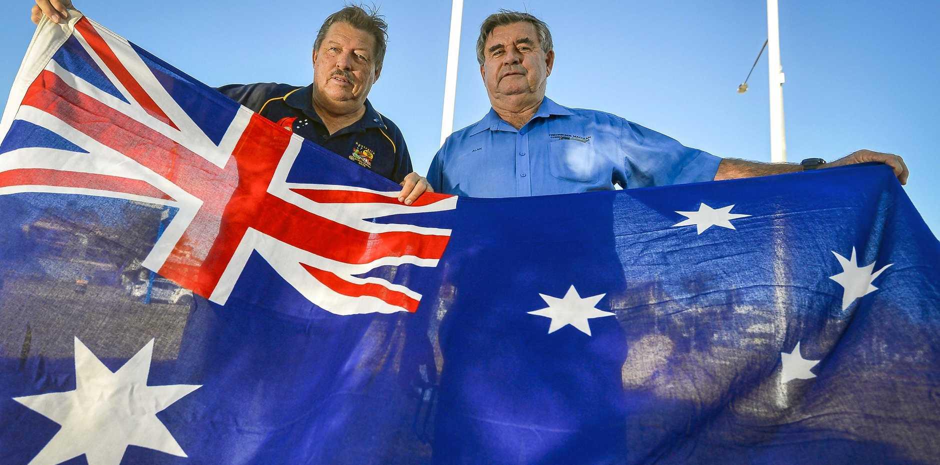FLAG DAY: South Gladstone Rotary Club Flag Marshall Stephen Mills and South Gladstone Rotary Club president Alan Maclean.