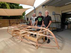 Men work together on boat building project