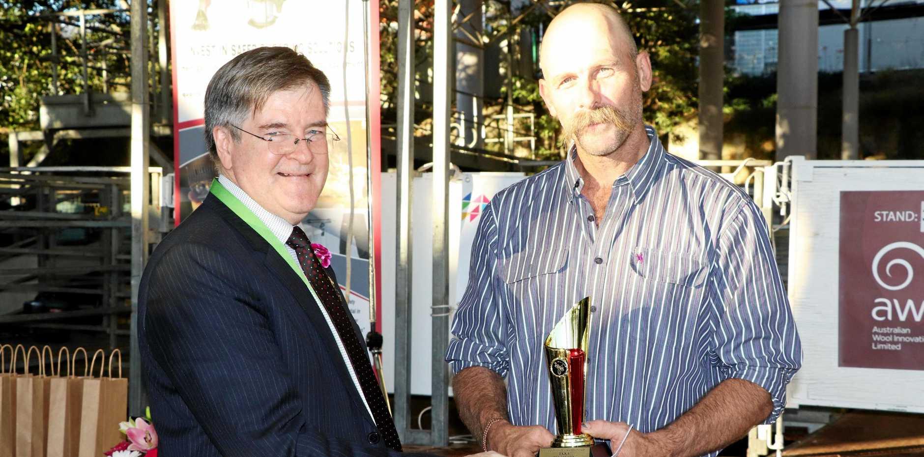 CHAMPION: RNA President David Thomas presenting Phil Schoff (right) with his award at the Ekka.