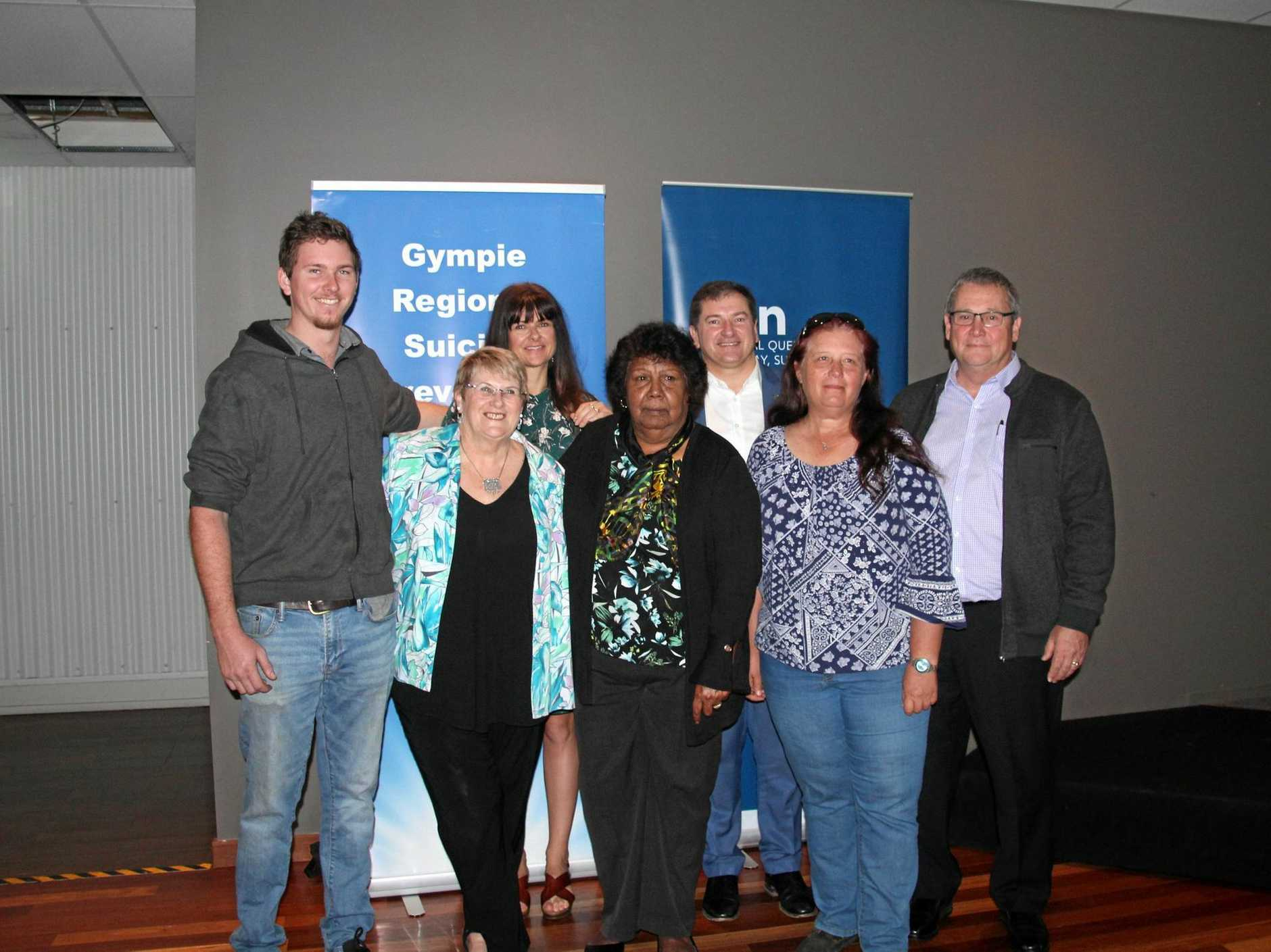 UNITED APPROACH: Riley Olsen, Pattie Hudson, Michelle McAllister, Aunty Lillian Burke, Llew O'Brien, Ruth Polley and Andrew Marriott at the suicide prevention launch on Tuesday.